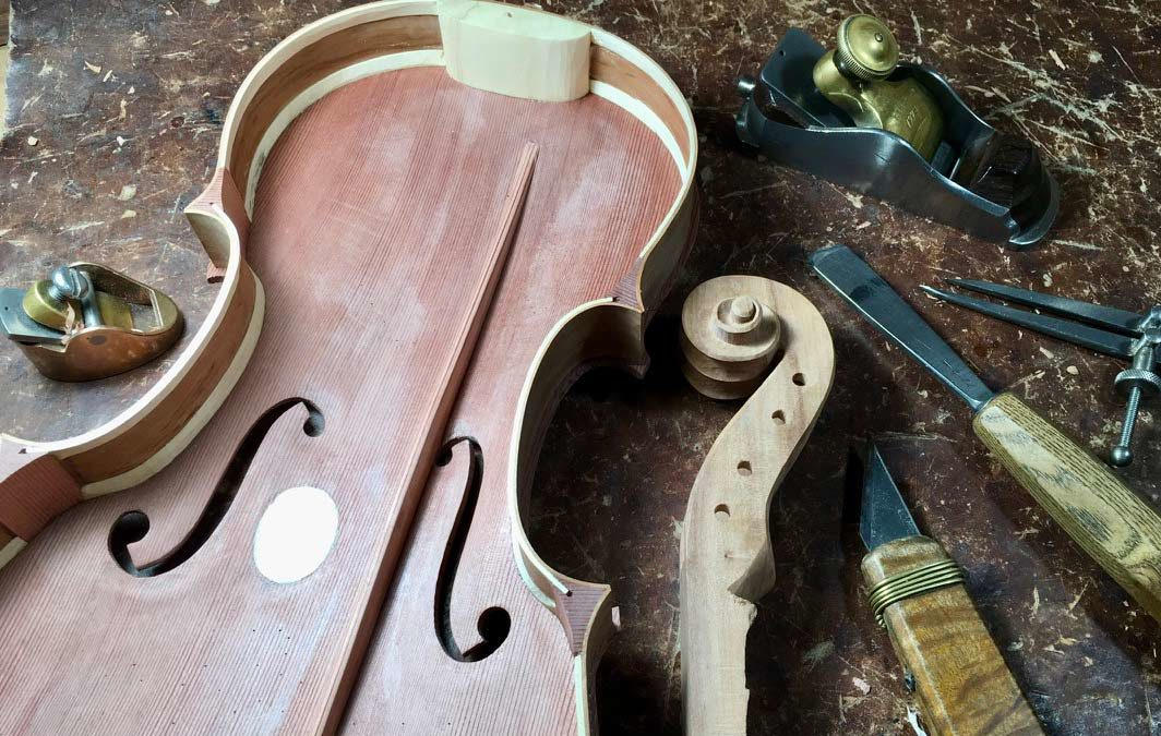 The bass bar, scroll carving and tailgut making